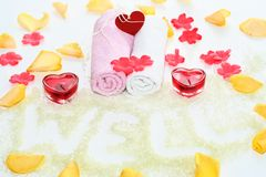 Romantic bath accesories. Romantic bath accessories with red heart candle Stock Photos