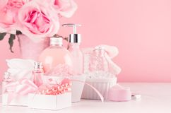 Romantic bathroom interior in pastel pink and silver color - flowers, bath accessories, pearls, gift, cosmetic products - cream. Romantic bathroom interior in royalty free stock image