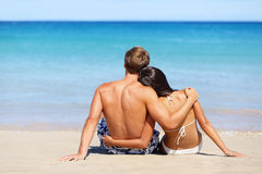 Romantic beach couple in love relaxing on vacation Stock Photos