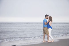 Romantic beach couple Stock Photos