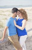 Romantic beach couple Stock Images