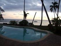 Romantic beach view from a pool. During sunset, Mango bay, Viti Levu, Fiji Royalty Free Stock Image