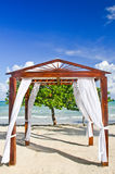 Romantic Beach Wedding Pergola. A view of the Caribbean Sea in the distance through a lovely beach side pergola decorated as a wedding venue at the Couples royalty free stock images