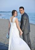 Romantic beach wedding at sunset Stock Images