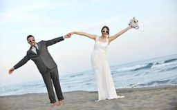 Romantic beach wedding at sunset Stock Photos