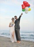 Romantic beach wedding at sunset Stock Photos