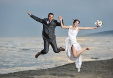 Romantic beach wedding at sunset Stock Photo