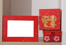 Romantic bears. On a red heart box, red photo frame, handmade Royalty Free Stock Photos