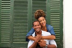 Romantic beautiful couple in embrace laughing. Portrait of romantic beautiful couple in embrace laughing Royalty Free Stock Photos