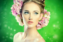 Romantic. Beautiful girl with flowers in her hair. Spring Stock Images