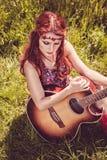 Romantic beautiful girl with her guitar Stock Photo