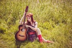 Romantic beautiful girl holding her guitar Stock Photo