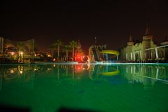 Romantic and beautiful night tropical location dark blue sky wit. H swimming pool, summer vacation concept Royalty Free Stock Image