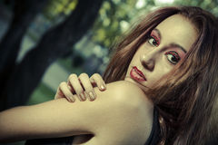 Romantic, beautiful woman in a forest, redhead with long hair. Beauty stock image