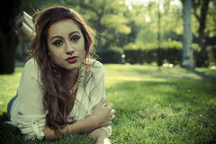 Romantic, beautiful woman in a forest, redhead with long hair. Beauty royalty free stock image
