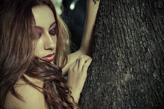 Romantic, beautiful woman in a forest, redhead with long hair. Beauty royalty free stock photography