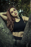 Romantic, beautiful woman in a forest, redhead with long hair. Beauty royalty free stock photos