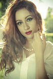 Romantic, beautiful woman in a forest, redhead with long hair Royalty Free Stock Photo
