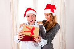 Romantic beautiful woman giving christmas present Stock Photo