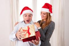 Romantic beautiful woman giving christmas present Stock Photo