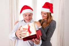 Romantic beautiful woman giving christmas present Stock Photos