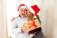 Romantic beautiful woman giving christmas present Royalty Free Stock Images