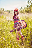 Romantic beautiful woman holding her guitar Stock Image