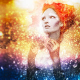 Romantic beauty with magnificent hair wandering in clouds. Studio fashion portrait. Royalty Free Stock Photography