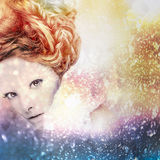 Romantic beauty with magnificent hair wandering in clouds. Studio fashion portrait. Royalty Free Stock Images