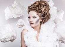 Romantic beauty with magnificent hair wandering in clouds. Studio fashion portrait. Stock Photo