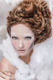 Romantic beauty with magnificent hair wandering in clouds. Studio fashion portrait. Royalty Free Stock Photos