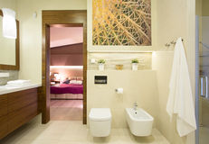 Romantic bedroom with private bathroom Stock Images