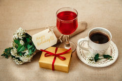 Romantic Birthday Breakfast.Cup of Coffee.Glass of Red Drink.Wish Card with Flowers.Present in Golden Box Royalty Free Stock Photos