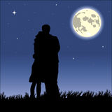 Romantic black night. Romantic couple kissing in a starry black night Stock Image