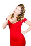 Romantic blond pin-up lady blowing party bubbles Stock Images