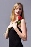 Romantic blond with red rose. Royalty Free Stock Photo