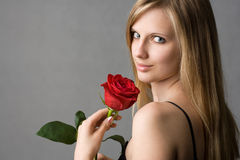 Romantic blond with red rose. Royalty Free Stock Image