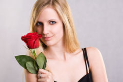 Romantic blond with red rose. Royalty Free Stock Photography