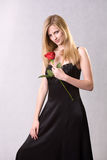 Romantic blond with red rose. Stock Image