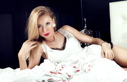 Romantic blonde woman in bed Stock Image