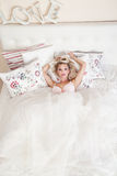 Romantic blonde woman posing in bed Royalty Free Stock Image