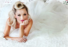 Romantic blonde woman posing in bed Stock Photo