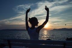 Romantic blonde woman on sunset. Royalty Free Stock Image
