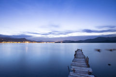 Romantic blue sunset with a jetty over a lake Stock Photos