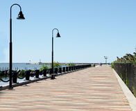 Romantic boardwalk near the water. Royalty Free Stock Images
