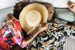 Romantic bohemian black couple on bed stock image