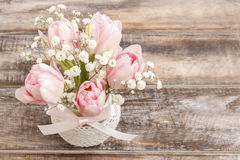 Romantic bouquet of pink tulips and gypsophilia paniculata Stock Images