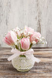 Romantic bouquet of pink tulips and gypsophilia paniculata Stock Photography