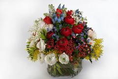 Romantic bouquet in a vase on a light background royalty free stock image