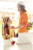 Romantic boy giving flowers to beautiful girl stock photos